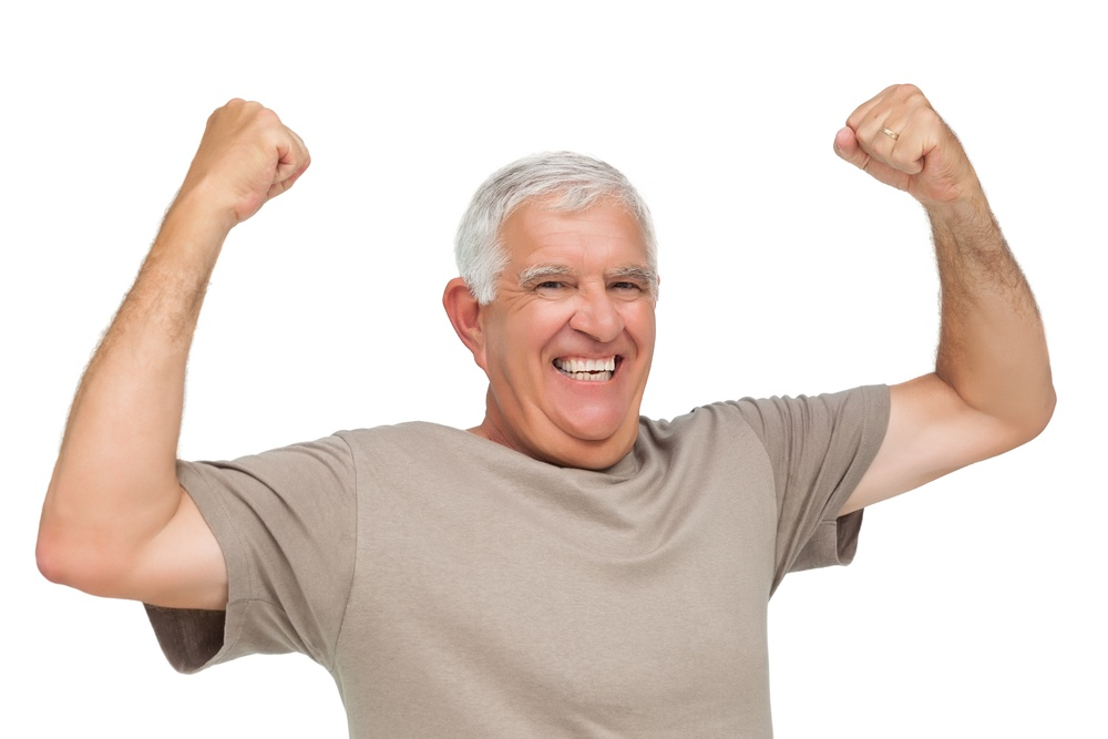 Portrait of a cheerful senior man with clenched fists over white background